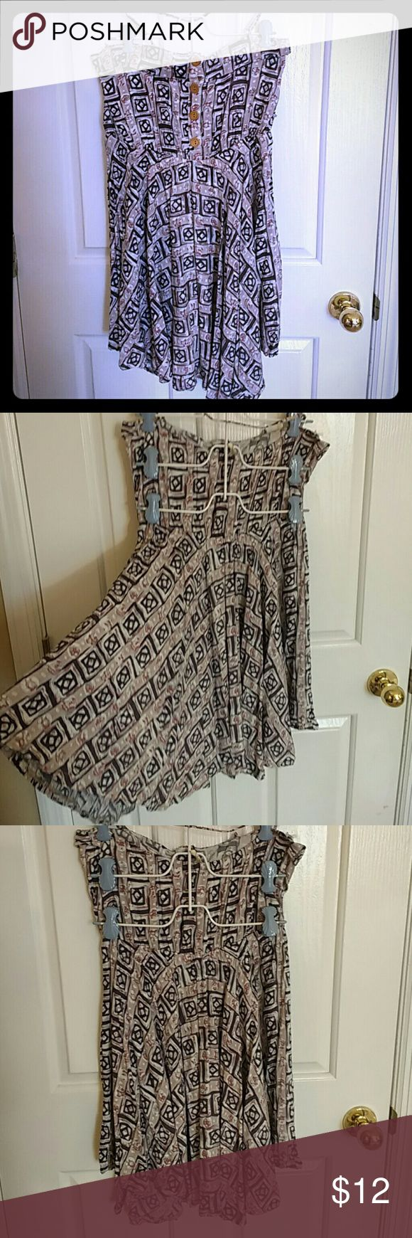 "EUC Francesca's Tribal Pattern Festival Dress This is a really pretty dress I bought from Francesca's a few years ago and only wore once. There's no size listed on any of the tags, but it was labeled a large in the store. It features wooden buttons on the front, an over the neck spaghetti strap, and a beautiful flowy a-line skirt. I measured the bust at ~36"" around and the skirt is a little asymmetrical measuring between 26-28"" from top of bust to hem. Comment with questions. Francesca's…"