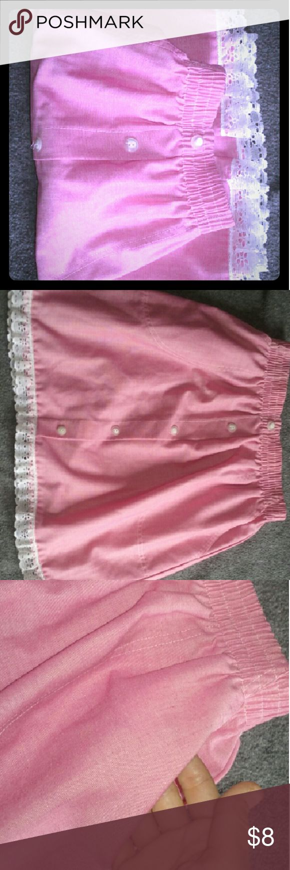 Cape Cod Lovely Pink with Lace trim Skirt Very pretty pink skirt has buttons down the front,however they are just for looks. Pockets on the sides and beautiful lace trim around the bottom. Has an elastic waste and lots of stretch in it.. 60% cotton & 40% polyester made in the U.S.A... Please ask any questions and thanks for stopping by... Cape Cod Skirts Midi
