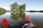 Canoeing along Lake Saimaa. Savonlinna, Finland.