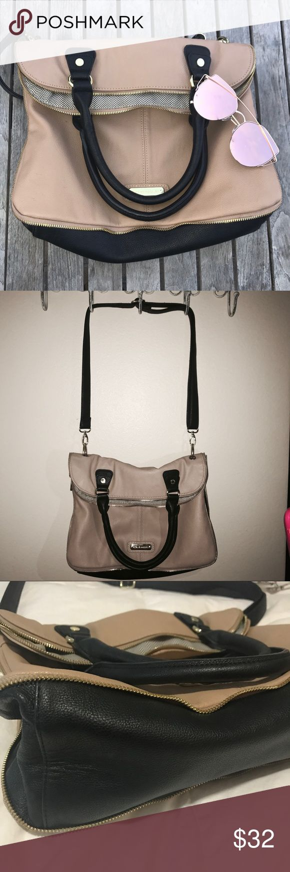 Steve Madden nude and black bag Authentic Steve Madden Nude and Black purse. Expandable bottom zipper to create more space in the bag. In excellent condition. One mark on the back of the bag located on the neon yellow accent pocket. See photos. Steve Madden Bags Shoulder Bags