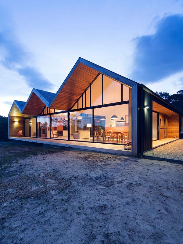 The Lookout House by Room 11 is a play on the farmhouse typology. The shape of the house with its extruded roof line creates a dramatic deck