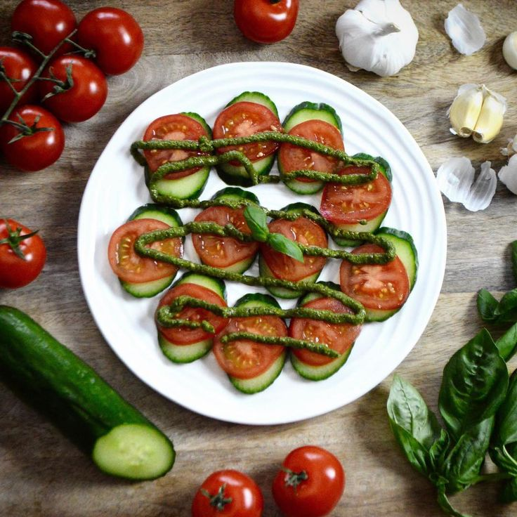 Tomatoes + Cucumbers with Raw Vegan Basil Pesto.  Click the link to Instagram for the recipe!