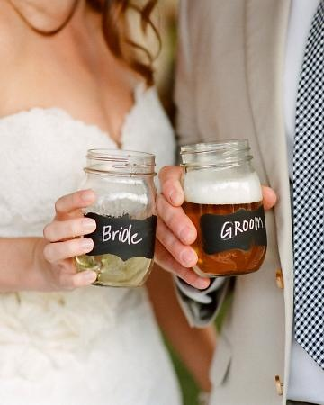 This couple transformed Mason jars by spraying them with chalkboard paint and then writing each guest's name on them with chalk. Better than disposable and they become favors.