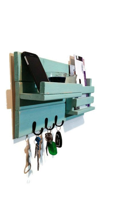 This Mail Holder with shelf features three metal hooks, a single slot for mail, one integrated display shelf with lip to keep electronics secure. Its ideal for entryway organization and perfect for keys, accessories, mail, phone and displaying your favorite small decorative items. This easy-to-hang shelf comes assembled with two screwed on saw tooth hangers for easy hanging The Renewed Décor & Storage 22 Wall Shelf and Mail Holder with 3 Metal Hooks Features • Wall shelf and mail organiz...