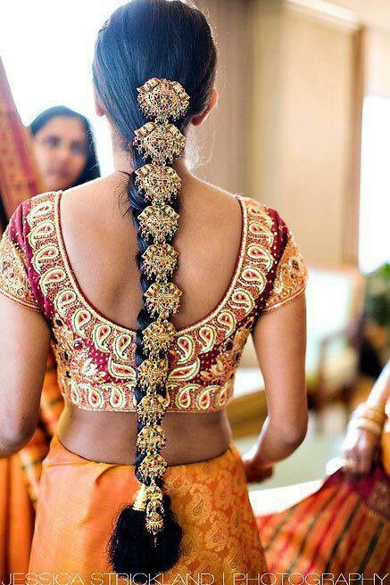 A traditional South Indian braid accessory works perfectly with the rich yellow silk saree to create a stunning Hindu bridal look - love this getting ready shot - Indian bride - Indian wedding - South Indian bridal saree - yellow wedding sari #thecrimsonbride