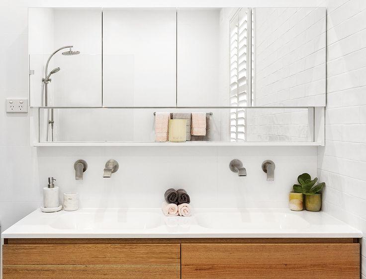 bathroom design by Luke's bathroom renovations. Wall hung timber vanity, brushed nickel taps.