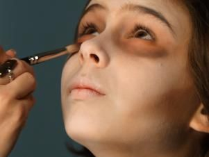 Shade under eyes by blending with brushes and eyeshadows in brown, gray, pink and red shades to make skin look sickly and sunken in.