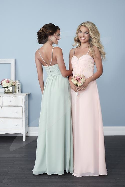 Balletts Bridal - 24210 - Bridesmaids by Jacquelin Bridals Canada - This stunning chiffon gown has an empire waist, a pleated bust brought together by a stylish center accent, and beaded spaghetti straps. Pictured in: Meadow, Petal Pink