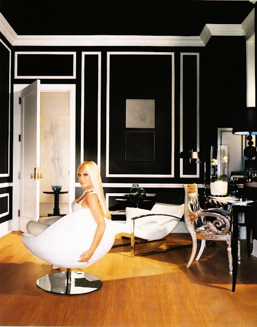 donatella versace and her work space. so glam. love the black and white trim.