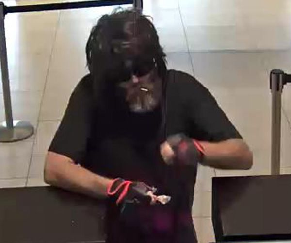 FBI Violent Crime Task Force is asking for the public's help in identifying a bank robber who wore a shaggy brown wig during a Houston area robbery.