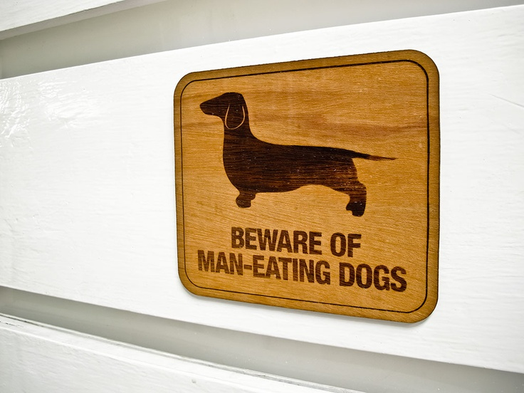 Beware of Man-Eating Dogs Signage
