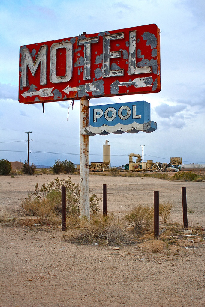 Abandoned motel sign. Yucca, AZ.