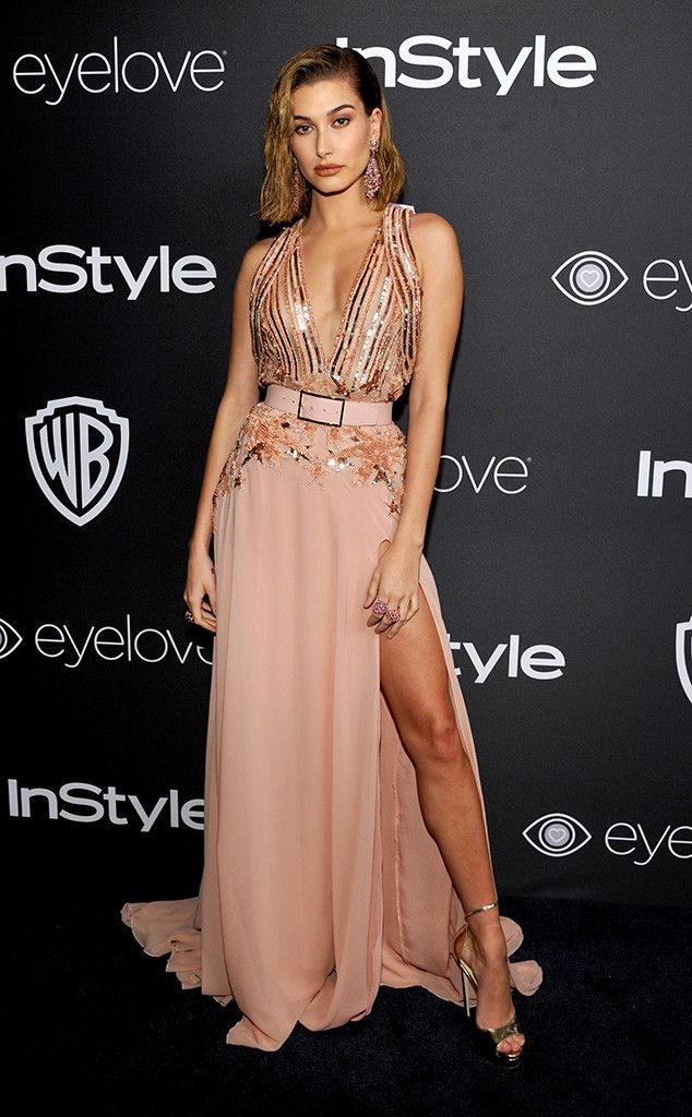 Hailey Baldwin from Golden Globes 2017 Party Pics  The model sported a blush belted floral gown with a thigh-high slit at the Warner Bros. and InStyle after-party.
