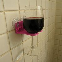 Bath tub wine holder!  My daughter sent this to me.  Love that she thinks about me.  Hope the shower is after 5 pm.!!!!