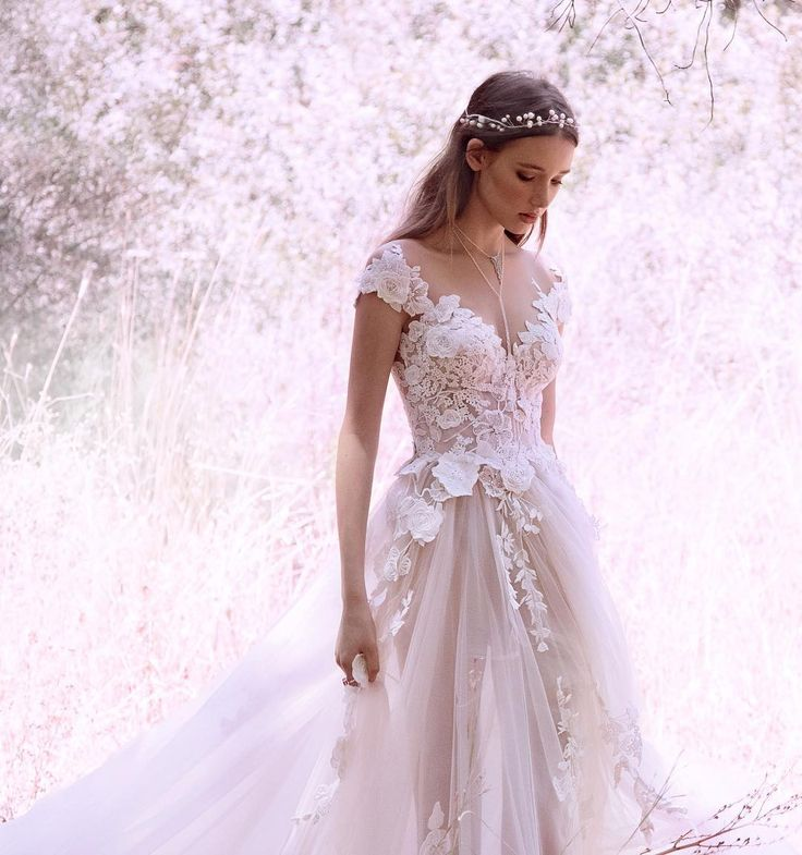 A fairy #ethereal feeling with the #GALA_902 strolling through the woods. #New #GALA #bridal #campaign