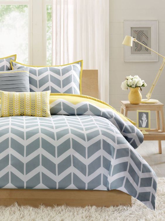 You'll love the perfect trendy color combination of yellow and gray in the Queen Nadia Grey White Chevron Comforter Set.