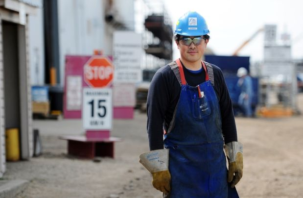 Peterson Dy left an office job at the University of Alberta to become a pipefitter and now works for Abraxus Construction.