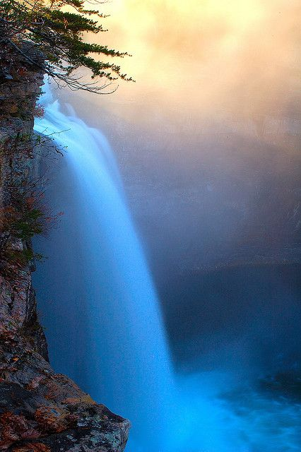 """Sunrise at DeSoto Falls by Wes Thomas on Flickr. """" I took my daughter to DeSoto Falls in Northeast Alabama this morning so she could experience this amazing place at full force. You can see the sun had just risen and cast a golden glow on the mist above the falls."""""""