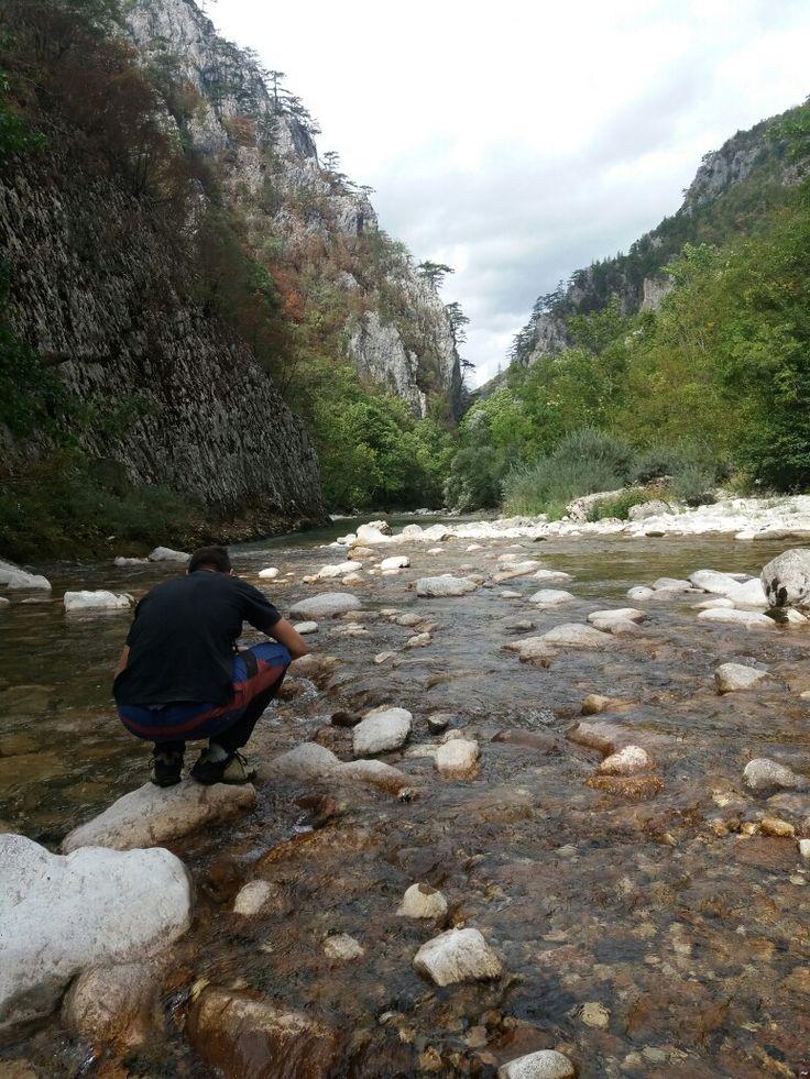 Travel buddy taking photo of beautiful Komarnica canyon. Montenegro rivers