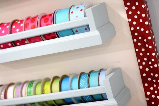 10 Ways To Use IKEA's Bekvam Spice Racks All Over the House: A crafting studio gets organized by mounting Bekvams to hold a large collection of ribbon. (7 Layer Studio)