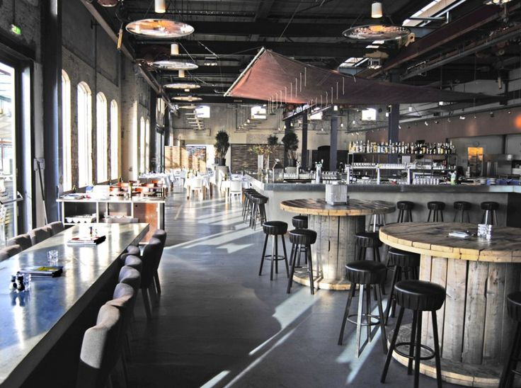 RESTAURANT STORK By CUBE + SOLUZ architects + Interior Shock - Design of café and fish RESTAURANT STORK an old factory in Amsterdam North.Restaurant Stork is situated in an old industrial building on a canal in Amsterdam. Its area is 1.100 sq.m. Warehouse has become the largest seafood restaurant...