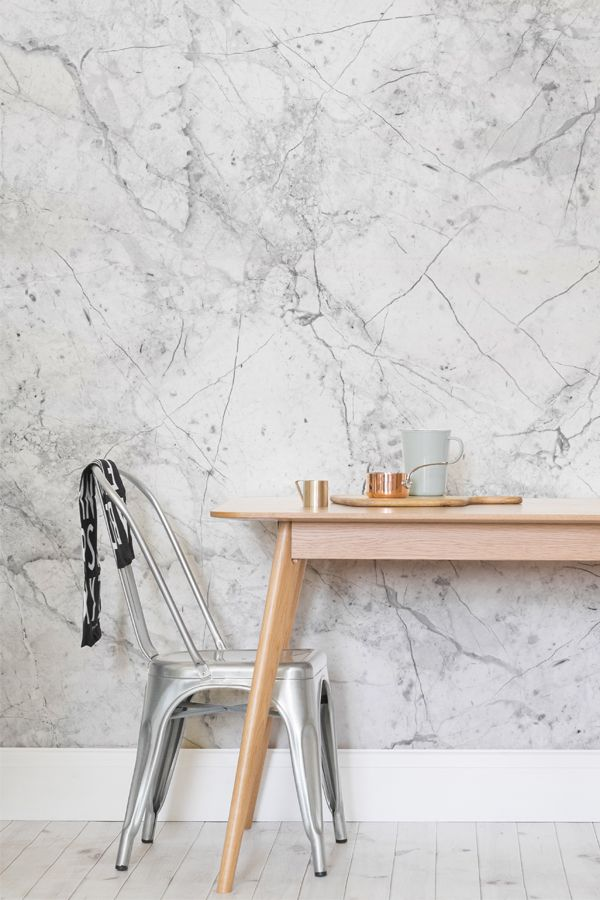 Super stylish and on-trend, this white marble wallpaper oozes cool. Add a touch of luxury to your interiors with this unique design.