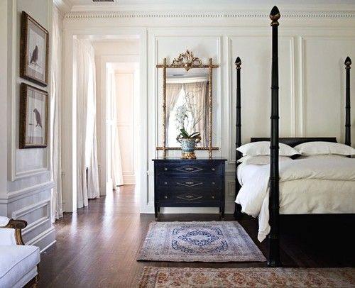 Elegant (and huge) bedroom.  Love the black + white palette; paneled walls; four poster bed; nightstand; plain white bedding (down + duvet)