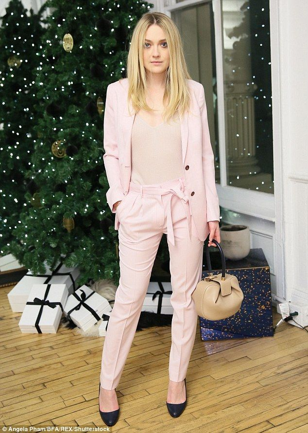 Style star: Dakota Fanning was up to her old style tricks again as she stepped out in style at the The Line Holiday Celebration in New York on Thursday