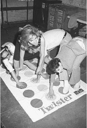 1960's - Teens playing the game 'Twister'. S)