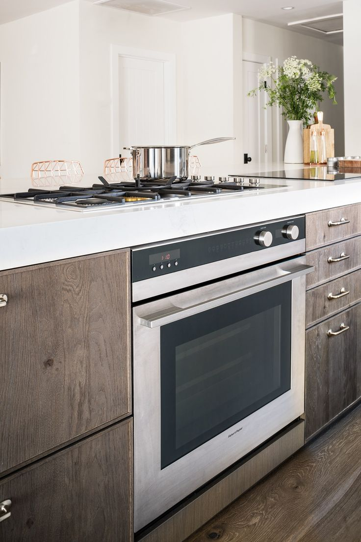 "Lefebvre opted to put an oven directly below his stove for easy access. ""I like to start with an open flame and then go directly to the oven,"" he says. ""This placement also feels safer with the kids around—I don't need to run to the other side of the kitchen with a hot pan."""