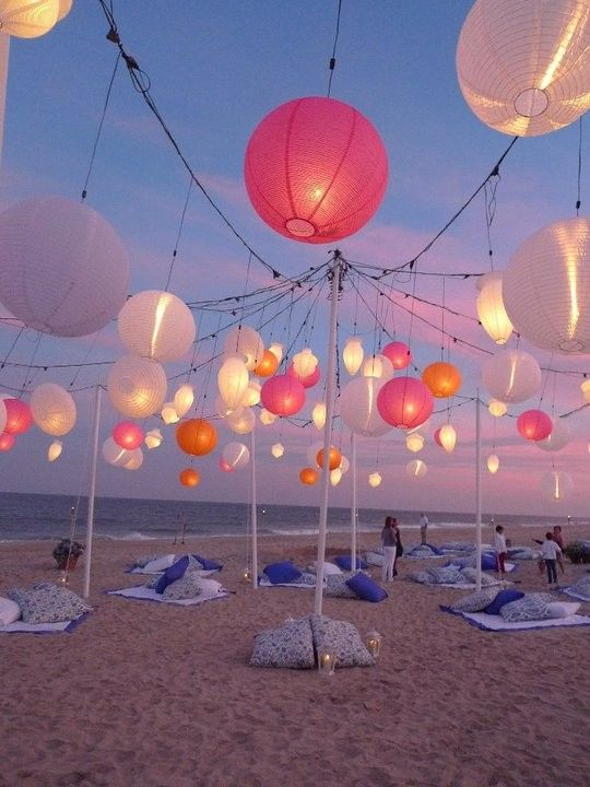 Elaborate set up to hang paper lanterns on beach but OH, how magical!!  Mod Vintage Life: Pink Paper Lanterns