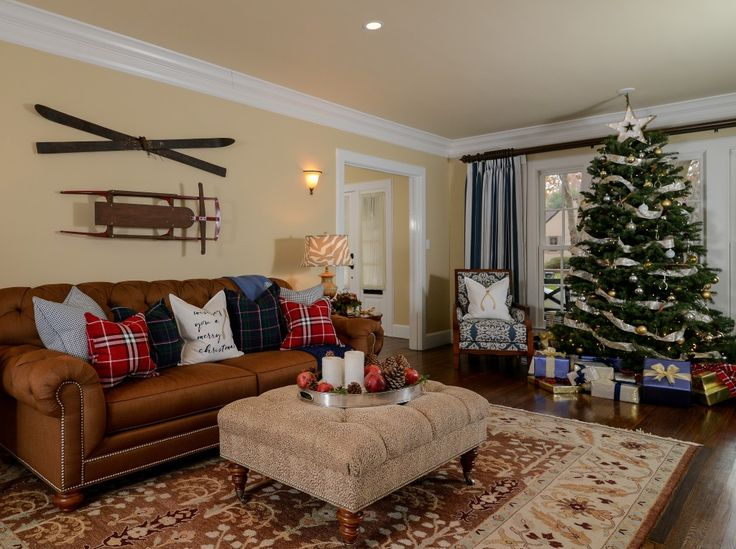 Traditional Living Room Decorated For Winter With Vintage Skis And Sled