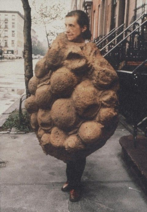 Louise Bourgeois, in a latex costume designed and made by her, in NYC 1975.