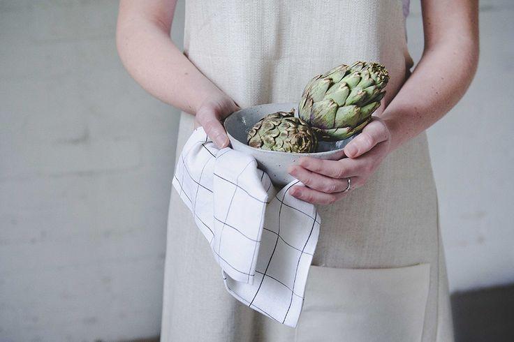 Ceramic bowl, grid print napkin and coss back apron