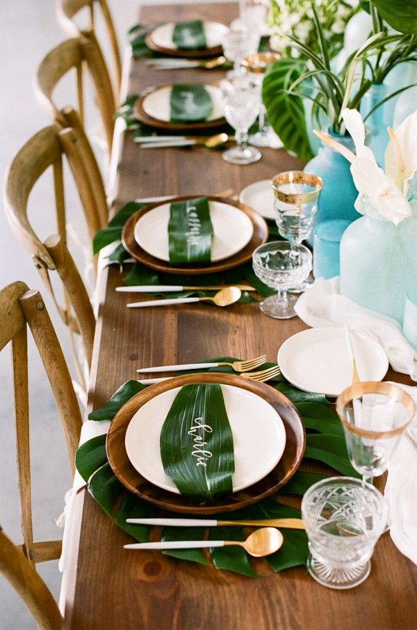 Tropical tablescape with calligraphy on leaves by Kindred Creations. - photo by http://kristamason.com/
