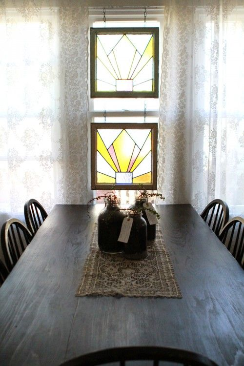 Window treatments don't have to only be curtains. In this Nashville home, the homeowner hung vintage pieces of stained glass to bring in some colorful light.