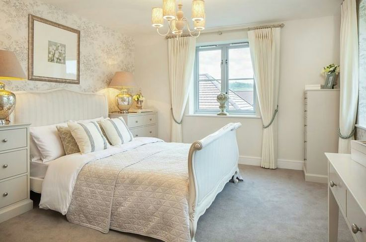 Interior Designed Guest Bedroom.  Upholstered French Linen Bed, cream on cream with blush accents.  Love the Eau de Nil beside tables.  Cala Homes 2016.  #calahomes #interiordesign #showhomes #frenchbed