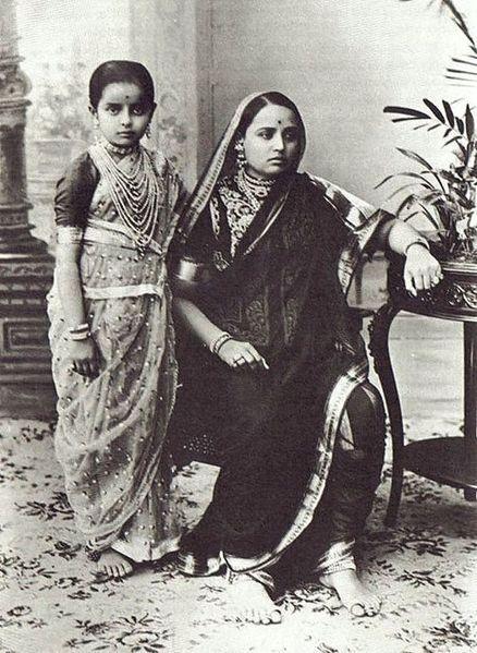 Indira Raje of Baroda as a young girl with her mother, The Maharani Chimnabai II of Baroda, wearing a 'Nauvari', a traditional Maharashtrian sari