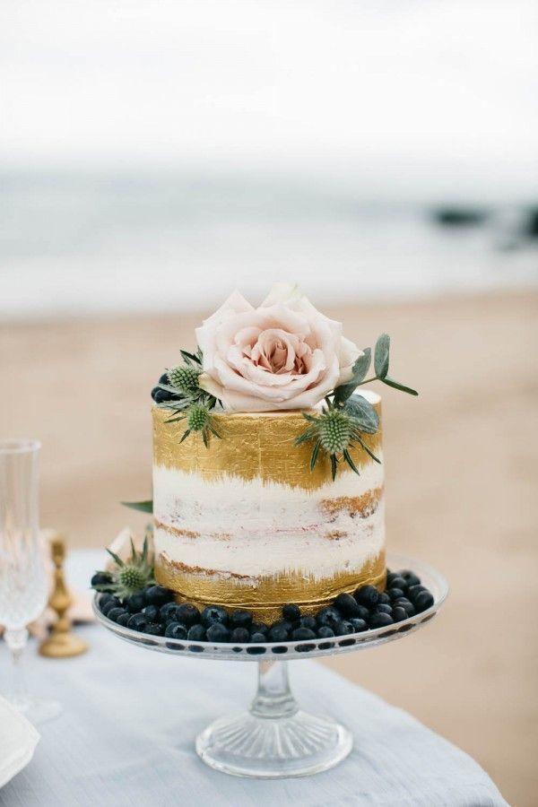 semi naked gold painted wedding cake idea for Irish spring wedding
