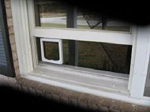 Clear Window Mounted Cat Door for Sash Windows, CatMate flap mounted in plexiglass slab with an aluminum frame.