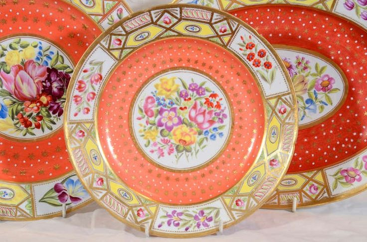 England circa 1810 A group of dishes in the Coalport Church Gresley pattern with striking yellow borders and bold orange ground filled with gold stars.