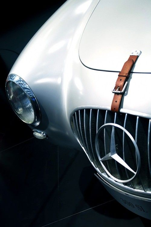 Classic Mercedes; I LOVE these leather straps! I've always wanted to see these on the boot of a Shelby Cobra...and/or the hood..