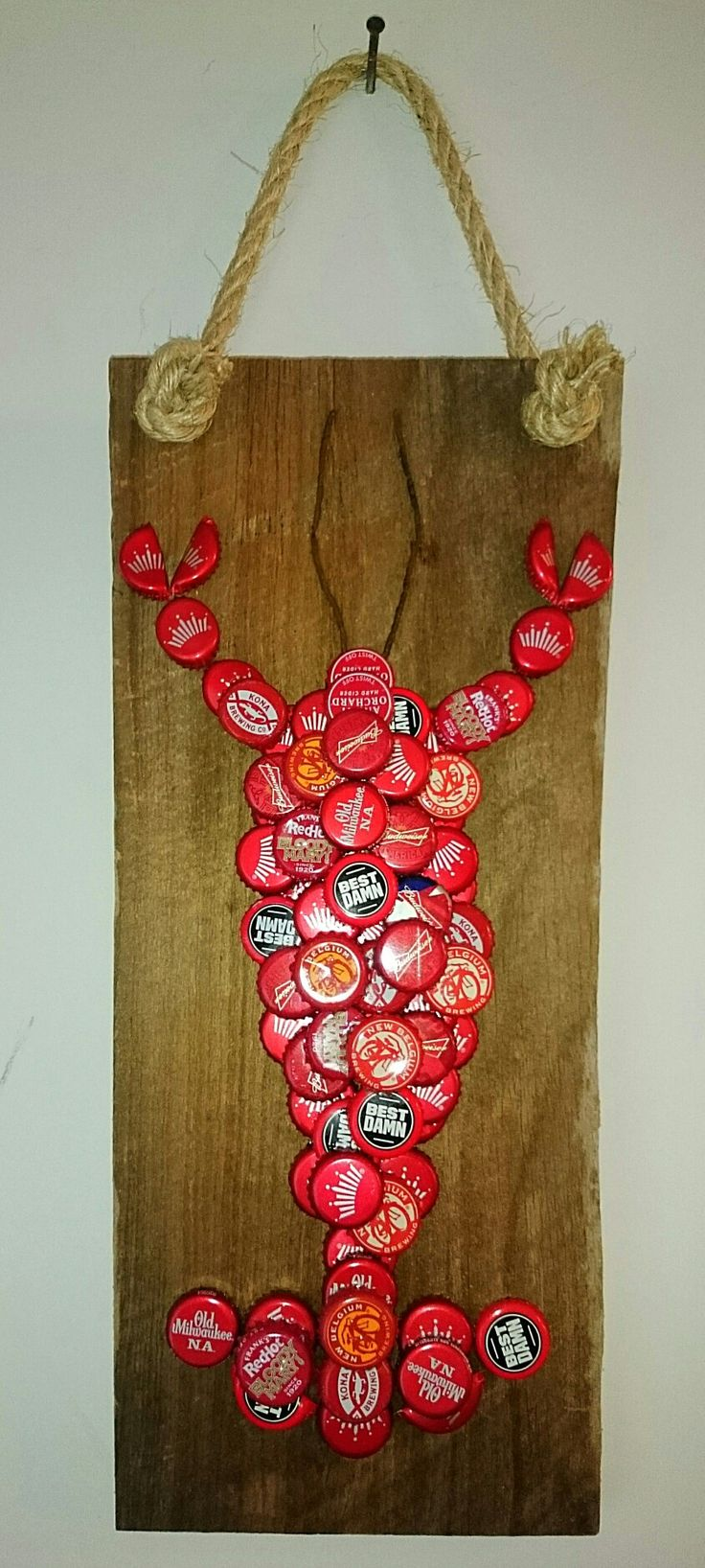 Best 25 bottle cap art ideas on pinterest bottle top for Bottle cap wall