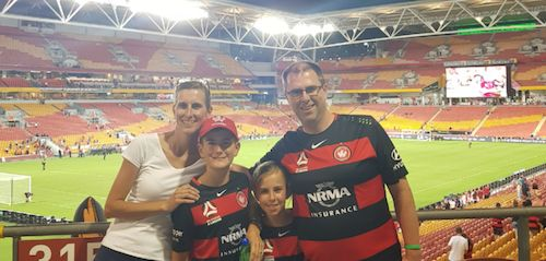 Western Sydney Wanderers fans, Allan McCarlie and family, combining a holiday with an away game at Brisbane's Suncorp Stadium - and a happy result. #ALeague 06.01.18