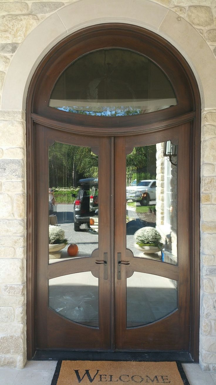 Here's another custom wood door stunner. The reverse arch on the transom is  so unique