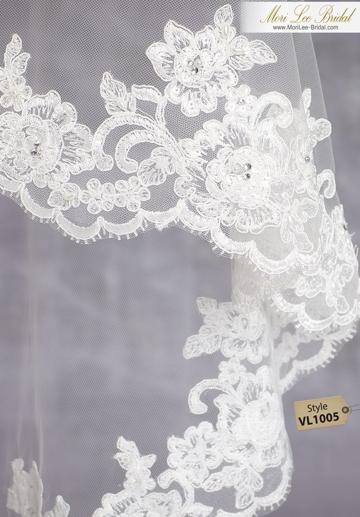 Style VL1005Lace Mantilla Beaded with Pearls, Sequins and RhinestonesAvailable in Fingertip Length (VL1005F) Shown, or Cathedral Length (VL1005C). Colors: White, Ivory.