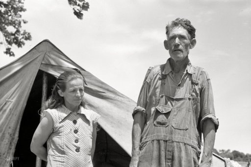 "June 1939. Another look at the fellow we saw here last week, this time with some company. ""Veteran migrant worker and his wife camped in Wagoner County, Oklahoma. He has followed the road for about 30 years. When asked where his home was he said, 'It's all over.'"" 35mm negative by Russell Lee."