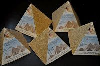 "We started by making pyramid shaped invitations out of sandpaper inviting everyone to the ""dig site."""