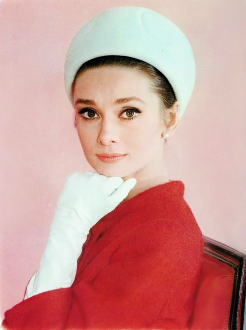 Audrey Hepburn in a Givenchy suit and hat worn while filming Charade (1963) in Paris with Cary Grant.