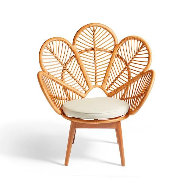 Our exclusive Daisie Rattan Chair is a playful yet sophisticated design    that reminds you to bloom creatively wherever you're seated in life.    This unique fan chair design features an open-style back that looks like    the blossom of a flower. A little Boho, a little urban chic mixed together    with comfortably lovely results. Our chair is meticulously handwoven by    artisans so it's nice enough to grace any living space. A durable    mahogany wood frame adds stability. The ...